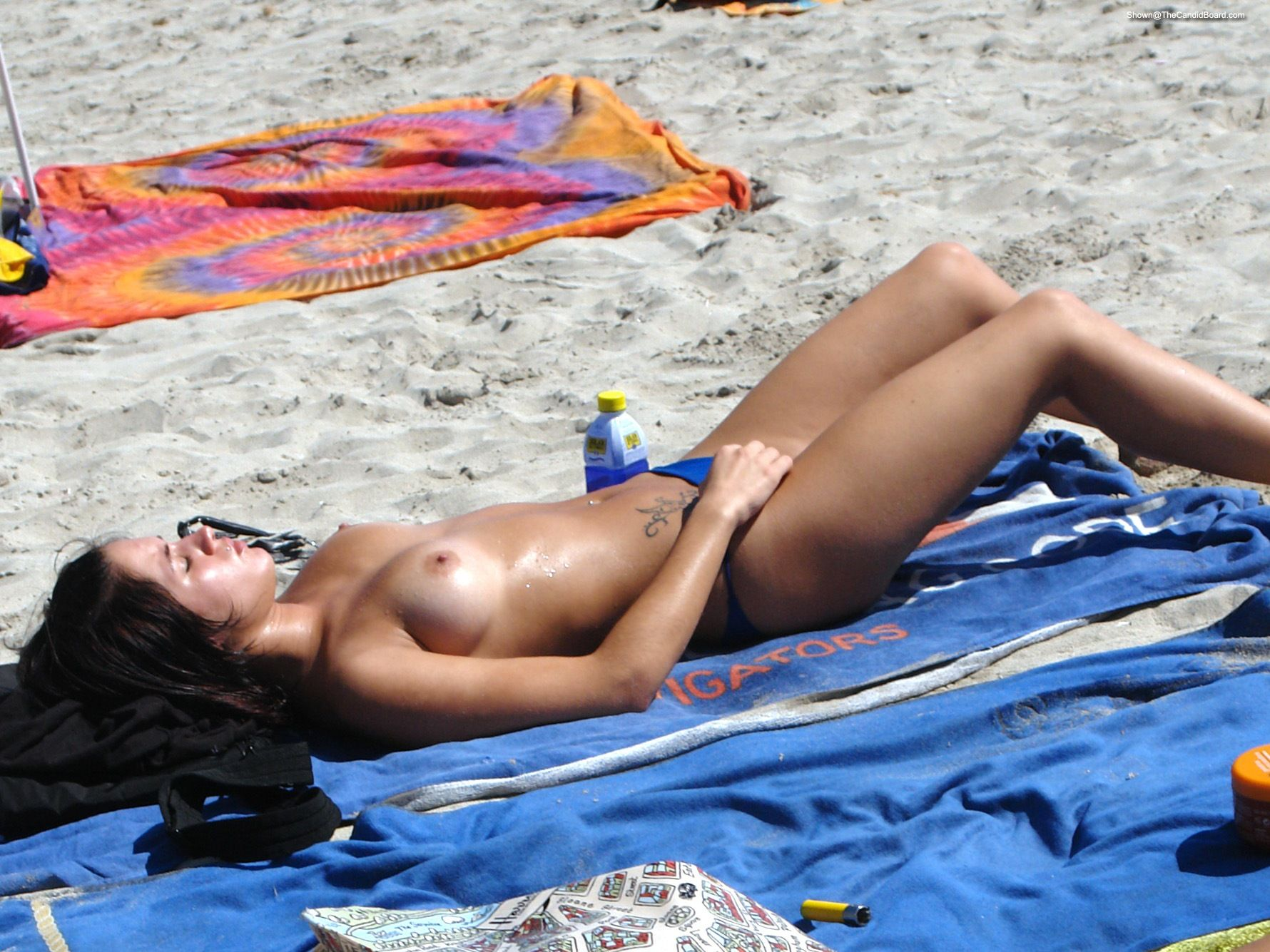 Beach toples at the Category:Topless women
