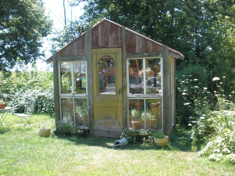 Greenhouse Made From Old Doors Is This Little Shed Wood Windows And