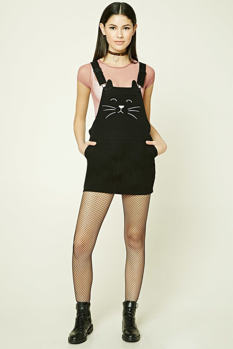 dfe0aaa047 A cotton woven mini overall dress featuring an embroidered cat face on the  front
