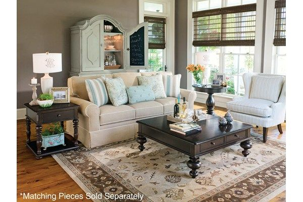 I'm liking the two different end tables. Not so matchy-matchy but they go together. Give the room some depth and detail.