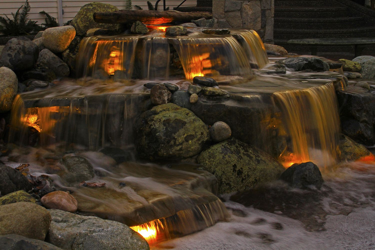 Illuminated koi pond waterfall a dreaming home for Pond waterfall construction