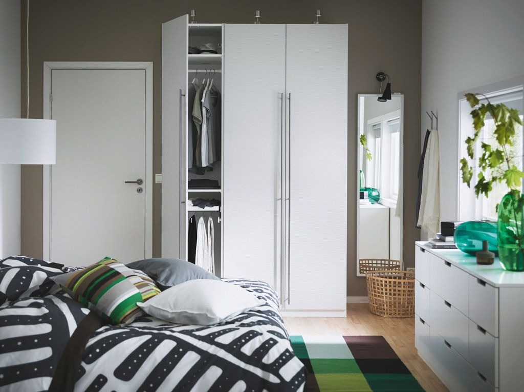 A bedroom with white PAX VINTERBRO wardrobe with stainless