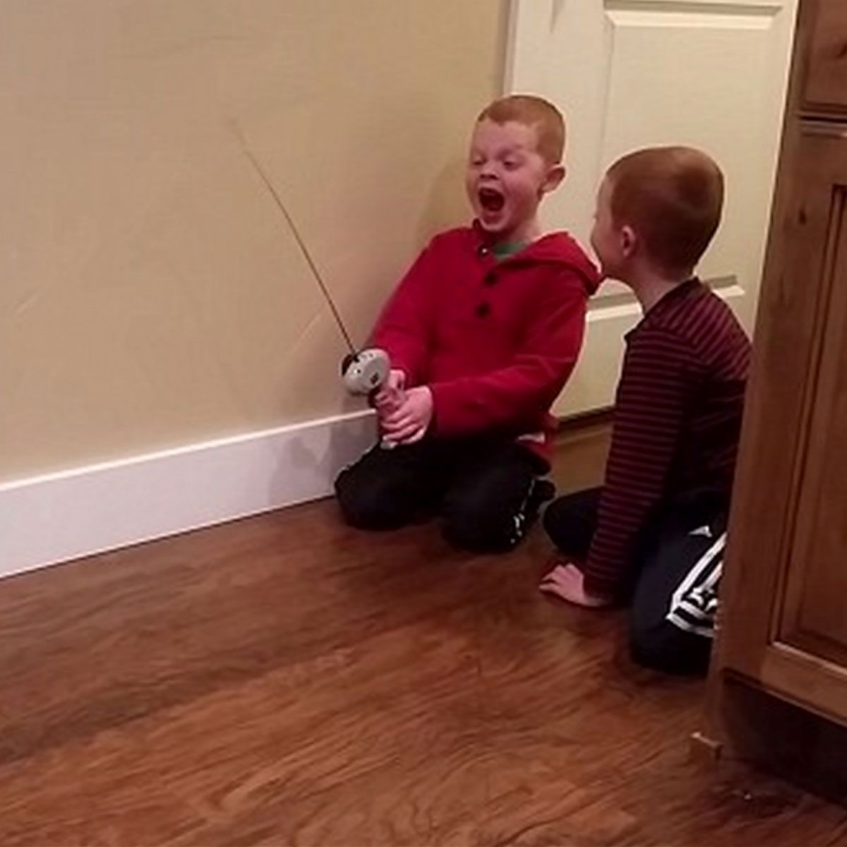 By gum boy uses his remote control car to pull out his