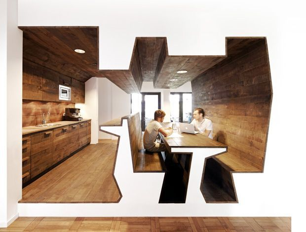 """JVM's Trojan Horse logo inspired its seating area: staff sit inside the """"carcass"""""""