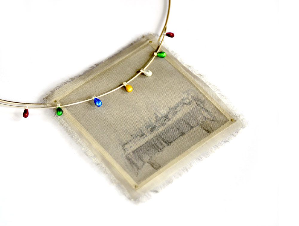 Fabiana Gadano. Necklace: Leoluz, 2014. Stainless steel wire mesh, sterling silver, enamelled pure silver, image transfer, construction. 7 x 7 x 0.5 cm.