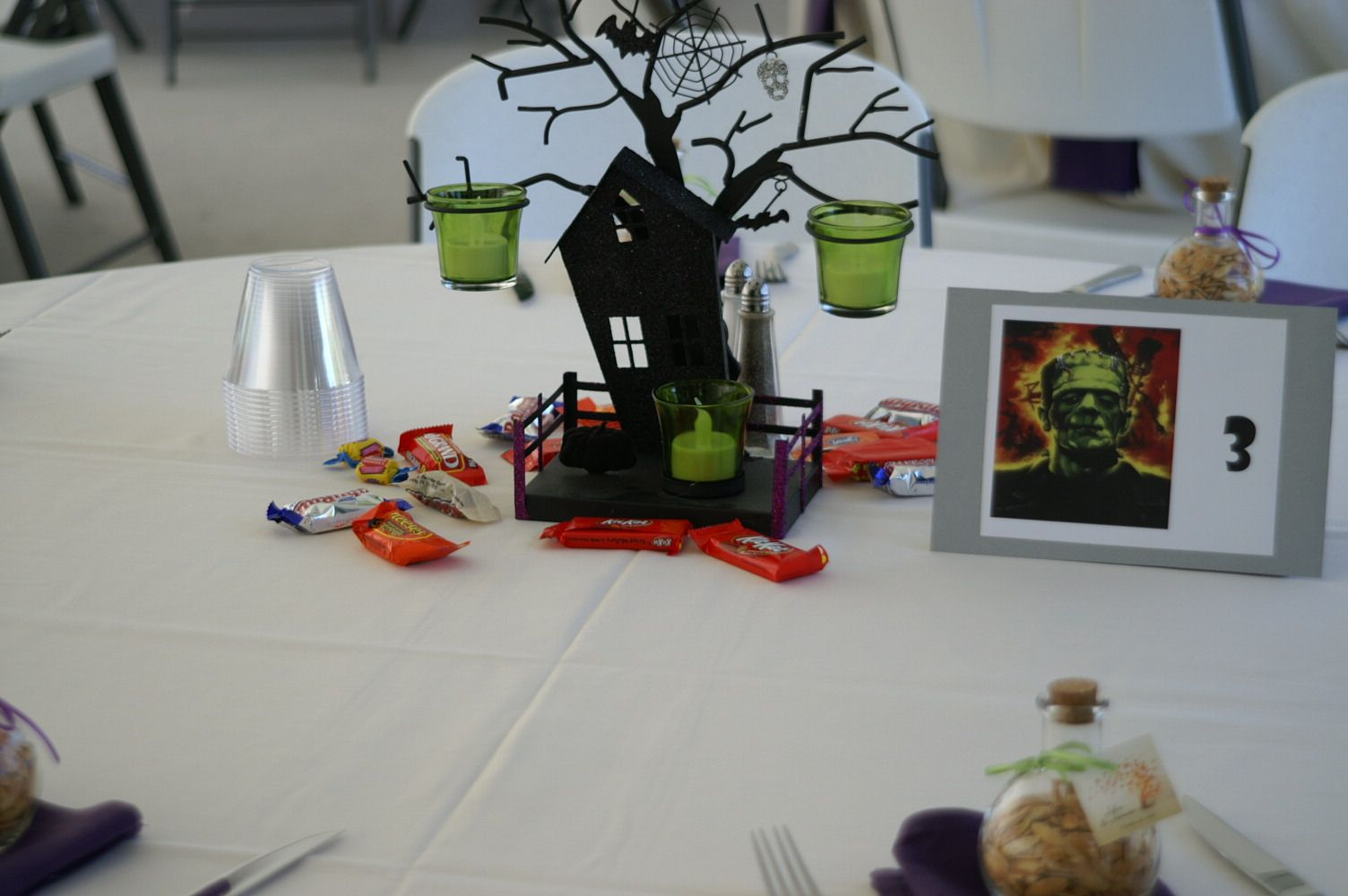 Halloween themed table centerpiece featuring a haunted house and