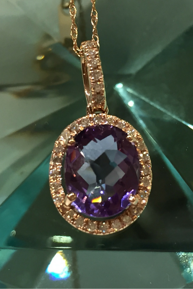 Beautiful amethyst and diamond pendant set in kt gold this piece