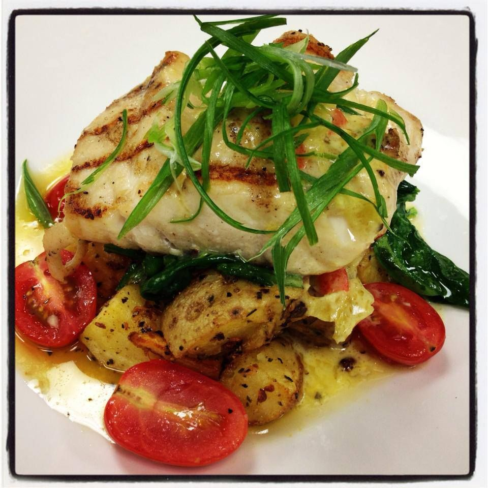 Grilled corvina with herb and garlic roasted yukon for Corvina fish recipes