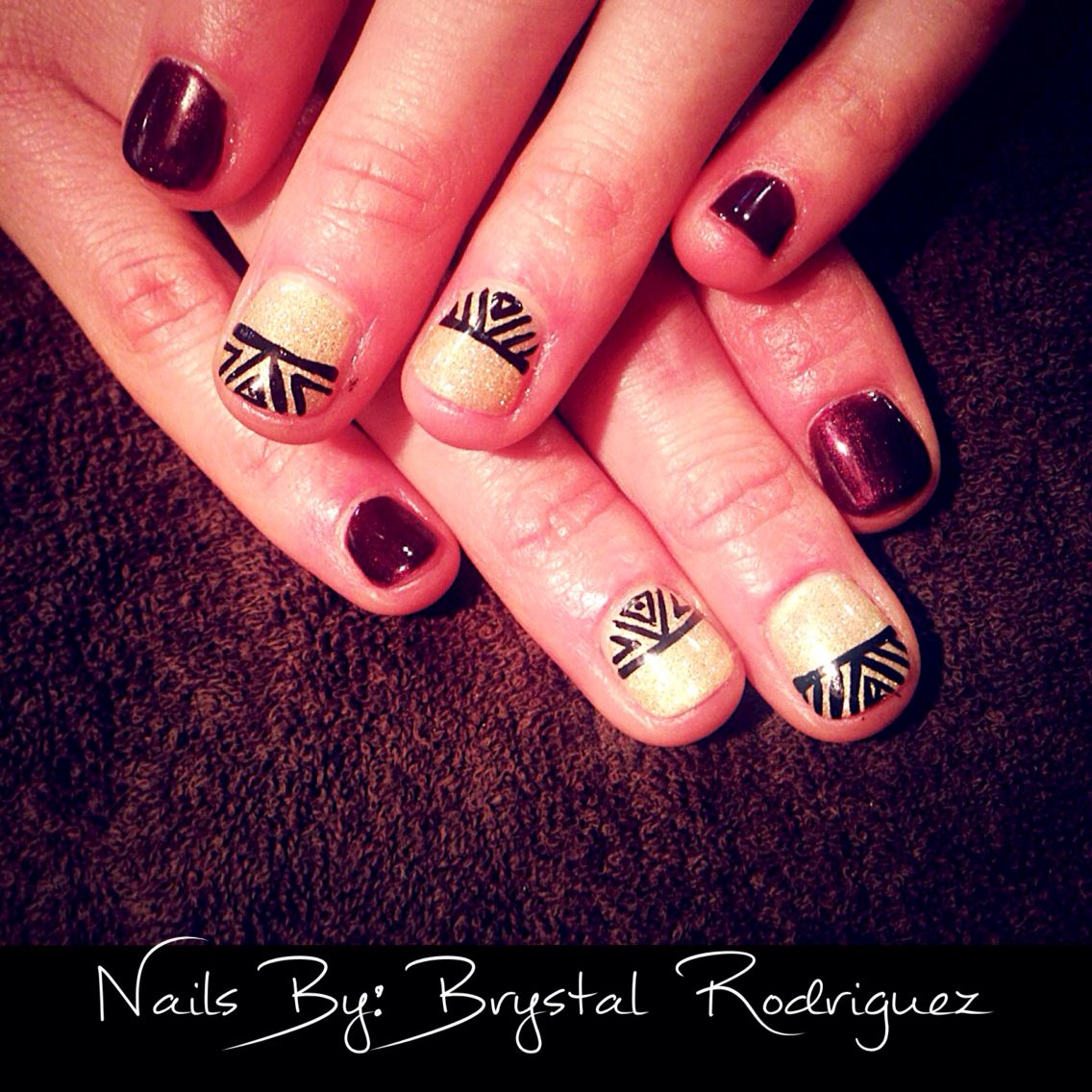 Gel polish manicure with nail art. Maroon nails, gold nails, fall ...