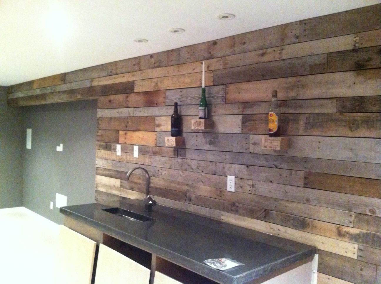 Pallet Wall In Rec Room Man Cave No Stain Applied All Natural Used Some Blocks From Pallets As Small Shelves Over Bar Pallet Wall Rec Room Charcoal Walls