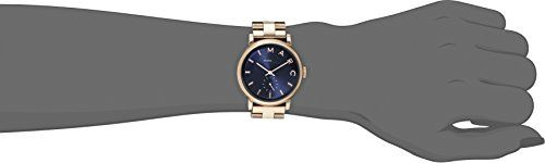 Marc by Marc Jacobs Women's MBM3330 Baker Rose Gold-Tone Stainless Steel Watch with Link Bracelet  This timeless piece from Marc by Marc Jacobs features a beautiful deep blue face with a gold case/band. Round watch in rose-tone featuring blue dial with logo and stick markers, as well as chronographic subdial at 6 o'clock Round watch in rose-tone featuring blue dial with logo and stick markers, as well as chronographic subdial at 6 o'clock 36 mm stainless steel case with mineral dial ..