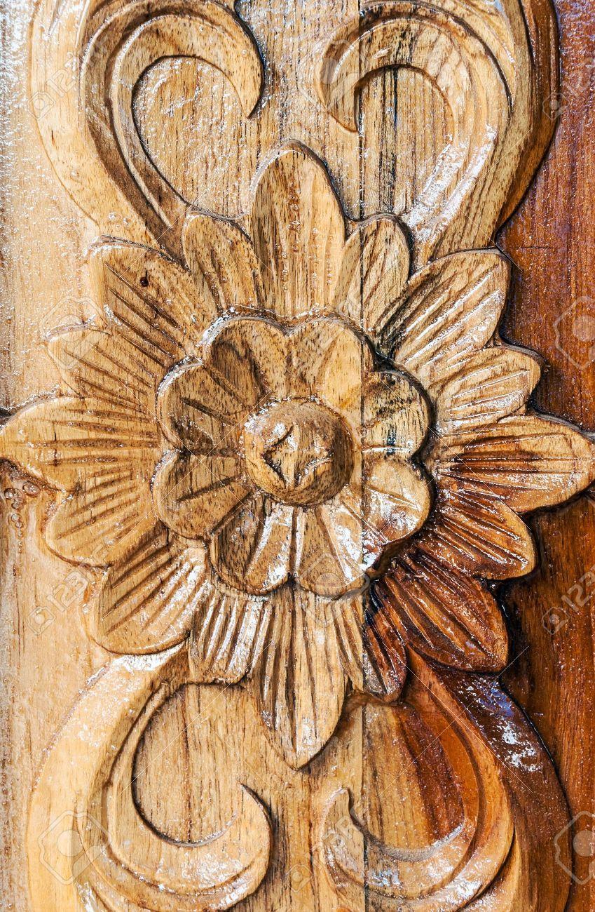 19279705 flower motifs carved on the wooden window stock photo wood carving 849 1300 - Modele sculpture sur bois gratuit ...