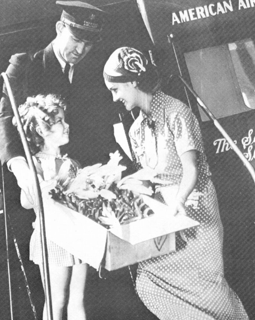 Shirley Temple receiving flowers for her Birthday via American Airlines, 1935.