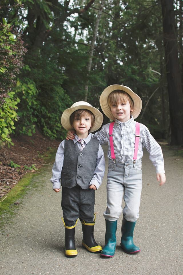 Straw boater, pink suspenders, gray pants and hunter boots. Dapper little tots!