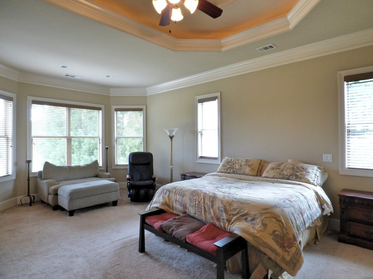 Master bedroom has trey ceiling and accent lights, crown