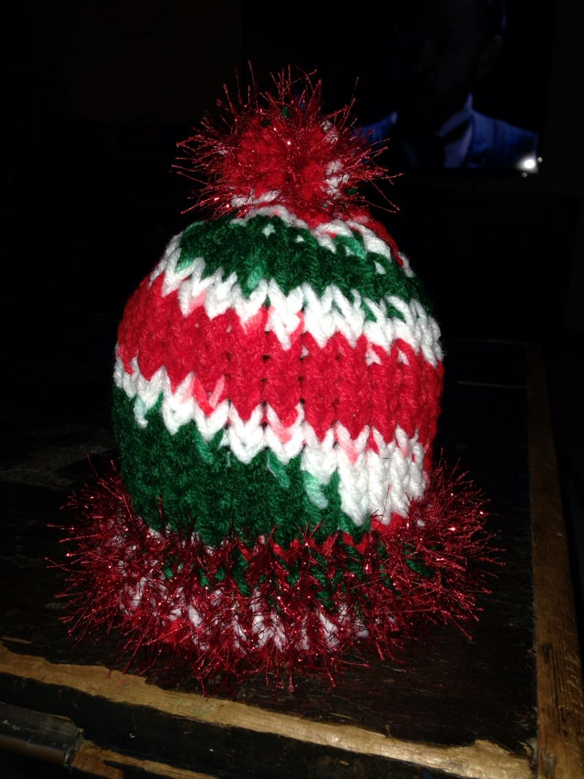 Loom knit Christmas hat for neighbors daughter  Added eyelash yarn