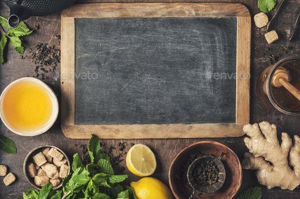 Tea composition by klenova Tea composition on rustic background tea mint lemon ginger Flat lay top view