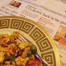 vegan Tofu Breakfast Scramble Recipe Breakfast and Brunch, Main Dishes with firm tofu, green pepper, purple onion, garlic, olive oil, cumin seed, nutritional yeast, ground cumin, ground turmeric, chili powder, salt, chopped tomatoes, salsa