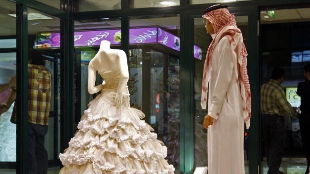 Saudi Dress Shop A Saudi Man Stands In Front Of A Wedding Dress At A Shop In Riyadh Saudi Arabia Arabic Wedding Dresses Men Dress Fashion Dresses
