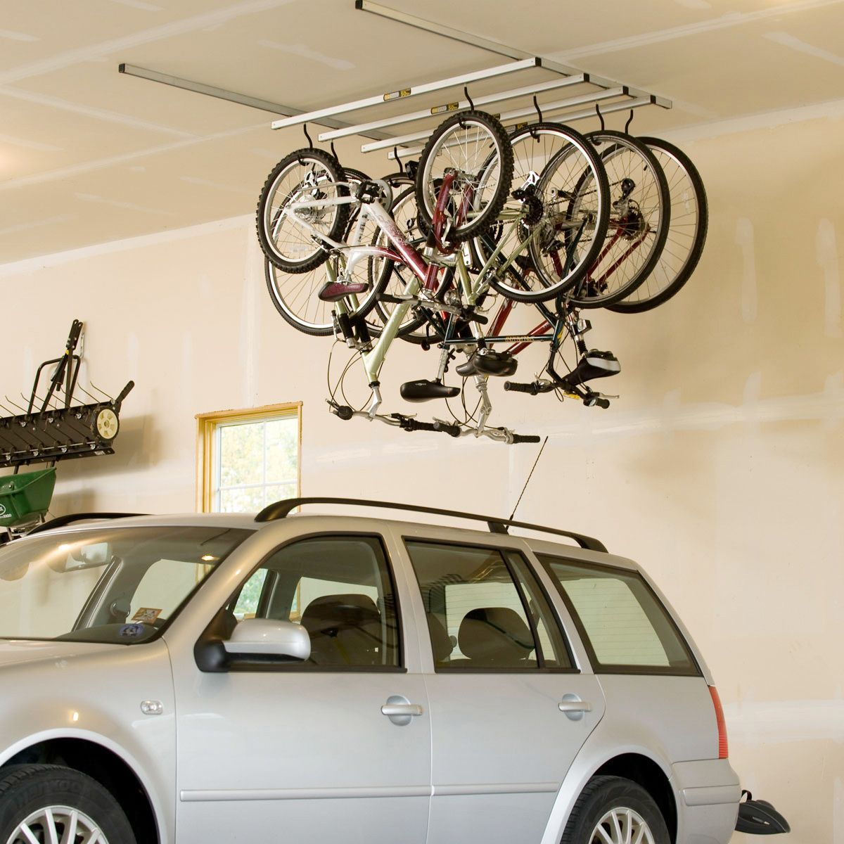 What S Better Than Smart Bike Stroage For Your Garage One That Maximizes The Empty Space Above Your Car Bike Storage Garage Bike Rack Garage Hanging Bike Rack