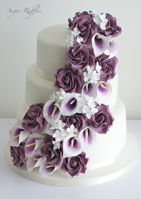 3 Tier Wedding Cake With Cascading Sugar Flowers Including Deep Purple Roses Picasso Calla Lilie Purple Wedding Cakes Wedding Cakes With Flowers Wedding Cakes