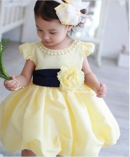 b273151f462 Sweet little bridesmaid in a pale yellow dress ...