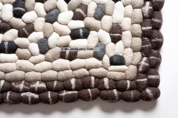 Felt Pebble Rug. there was a similar one at the Las Vegas market show Summer 2010 that I fell in love with that was a prototype. Now I know I can get it!