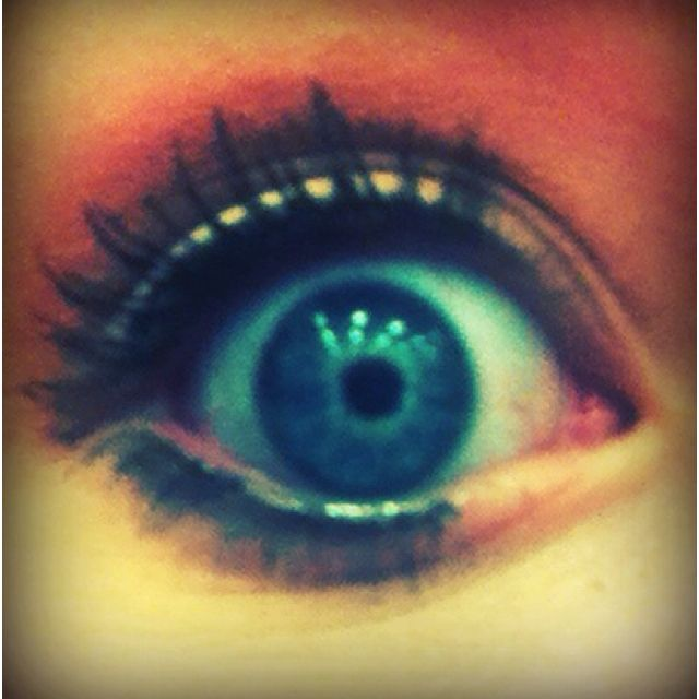 Blue eyes with a red highlight.