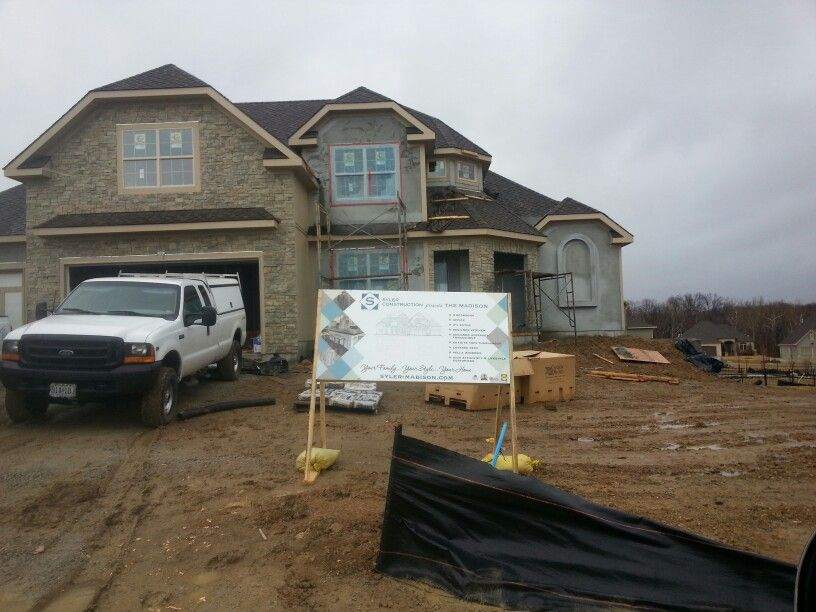 The exterior stone and maintenance-free acrylic stucco are now on