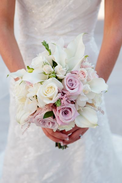 Roses, spray roses, mini cymbidium orchids, white dahlia, mini calla lilies, and mauve/pink astilbe bouquet featured in the 2013 Wedding Planner & Guide | GardenLaurels.com | SarahSeeley.com