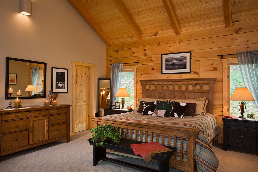 Master Bedroom With Exposed Heavy Timber Vaulted Ceiling