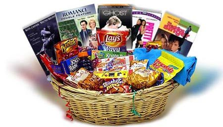 DVD or BlueRay basket as centerpiece , put in cool container, maybe from bestbuy, target, fryes.... could do kid theme, scary movies, harry potter, etc
