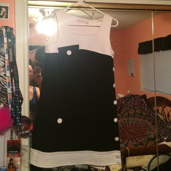 Retro button dress Size small. Purchased at a boutique on melrose blvd. size small. Snap buttons on side. Black and white color. Adorable! Urban Outfitters Dresses