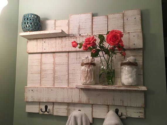 Rustic Towel Rack made from pallet wood, painted and distressed to a white-washed finish with bronze hardware  Measurements 24x 22x 2  Our items are made with reclaimed/re-purposed wood, so there may be nail holes, scars, cracks and blemishes in the wood, adding to the look of each individual piece. This being said, we take special precautions with those imperfections, so they do not compromise the quality of our work. Your piece will appear visually similar to the one in photographs, bu...