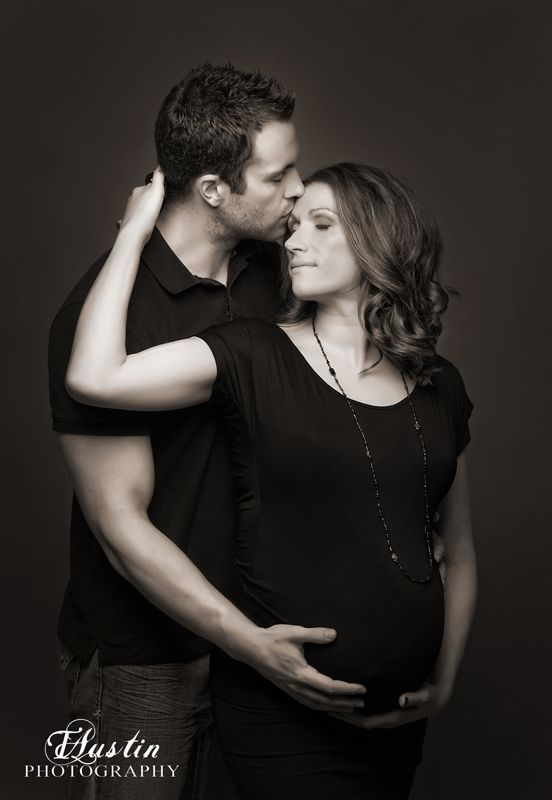Elegant black and white maternity photo with husband in the studio  Issaquah Maternity