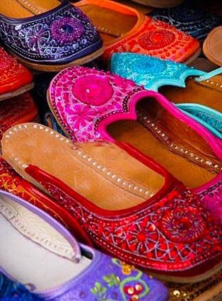 a7f5c7e62 Colorful hand made Indian slippers for sale at an outdoor market Indian  Shoes