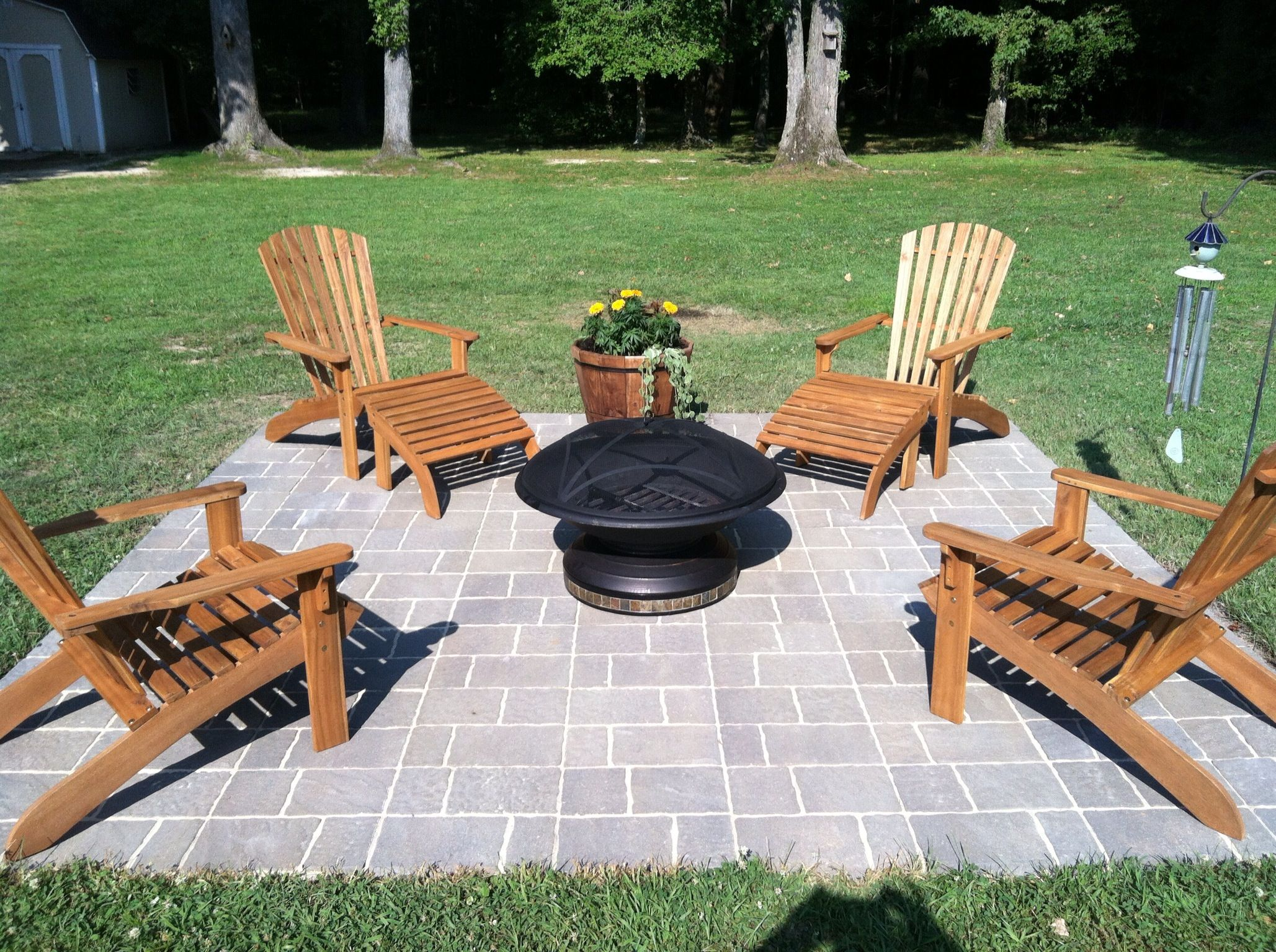 Our New 12x12 Paver Patio Space Completed This Weekend With Fire Pit And New Wooden Adirondack Chairs Amp Planter F Patio Pavers Backyard Fire Pit Backyard