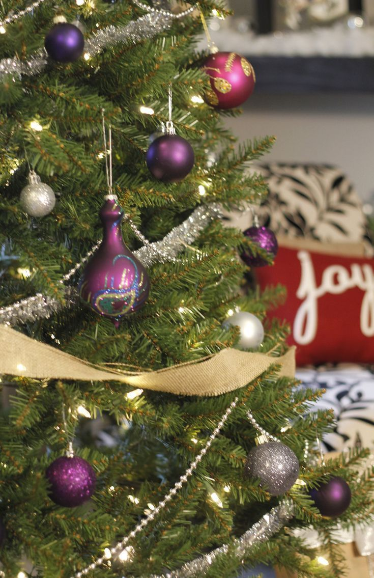 A Silver & Purple Glam Christmas Tree with glittery ornaments and some rustic burlap. Check out this gorgeous tree for more beautiful tree inspiration!