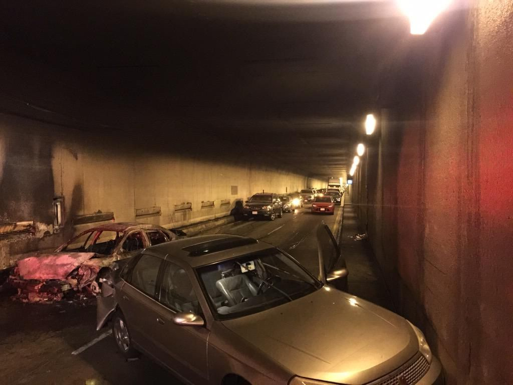 A car caught fire on the eastbound bore of the Caldecott Tunnel Monday morning, Mar. 16, 2015.  Dozens of people fled from their vehicles on foot. <span class=meta>(Twitter/@Oaklandfirelive)</span>