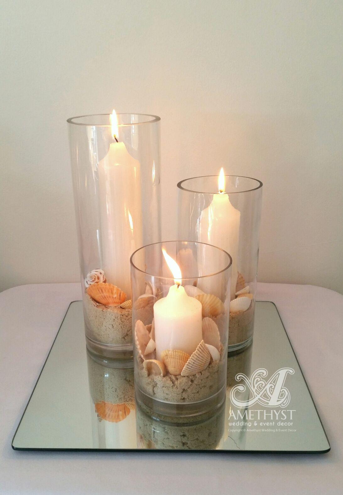 Elegant beach wedding centerpiece using cylinder vases