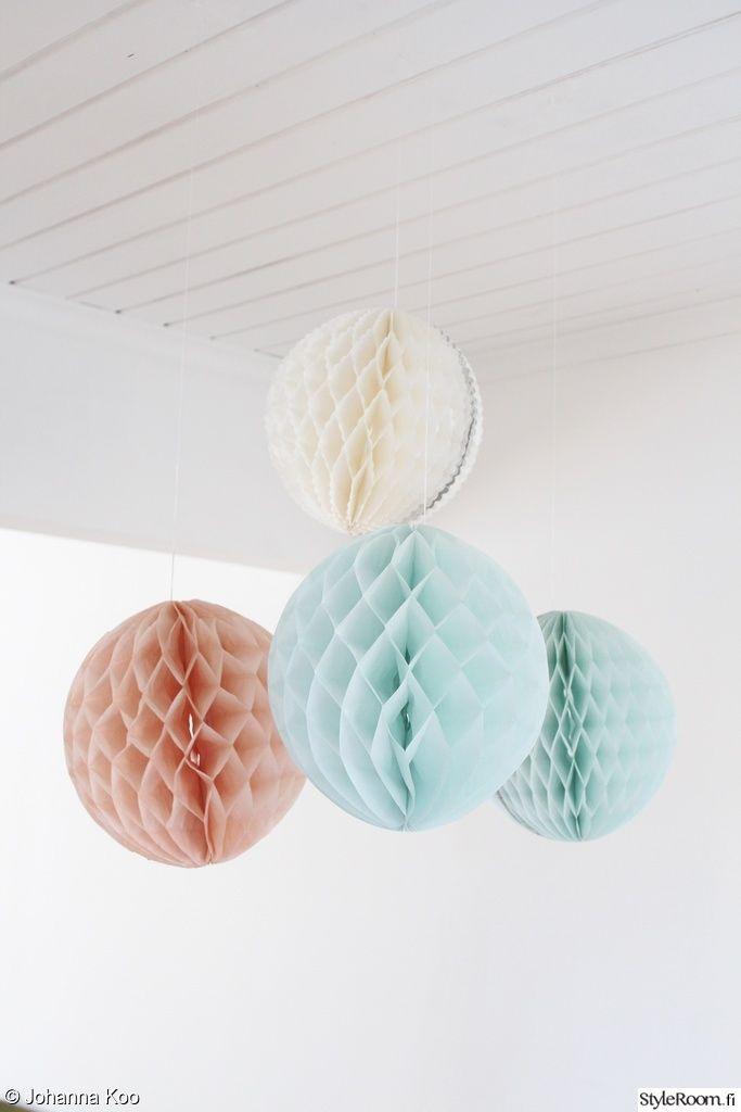 decorate a children's room with paper ornaments in  pastel colors