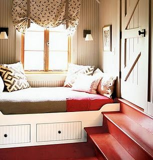 Colour scheme, built-in seat, beadboard, barn door, red stairs...I just love this space.  So me :)