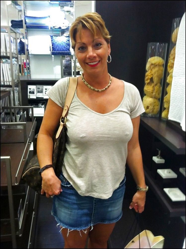 Candid Mature Woman Shopping in white romper