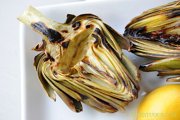 Grilled artichokes: Each cavity is filled with its own lemony butter dipping sauce that marinades the artichoke heart while the leaves get a nice smoky char
