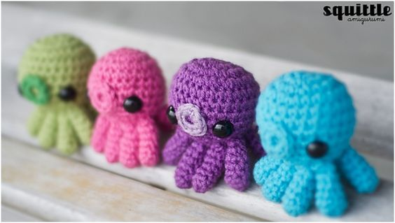 TOP 10 Cutest little DIY Amigurumi free patters - Who knew that those octopuses can be so cute? With the little O for a mouth they look ready to give you a kiss.