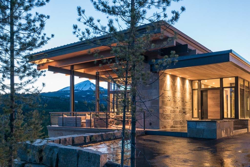 mountain modern home hovers above the montana wilderness