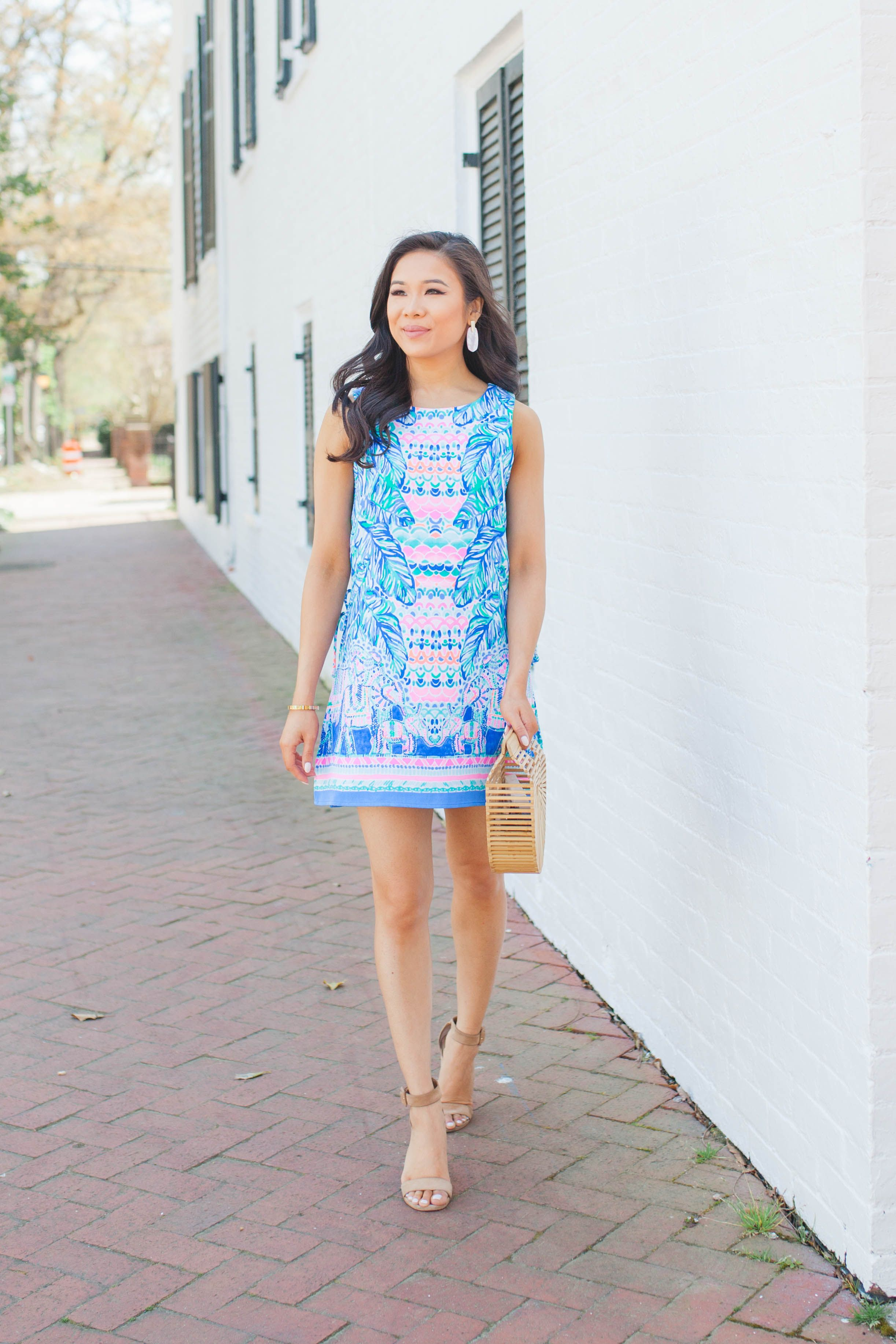 da160372e1ee6 Lilly Pulitzer Donna Romper with Cult Gaia bamboo bag and Kendra Scott  earrings on blogger Hoang-Kim
