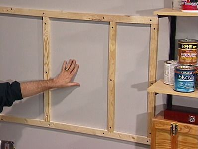 Installing pegboard...don't forget some kind of riser or you can't get the hooks in!