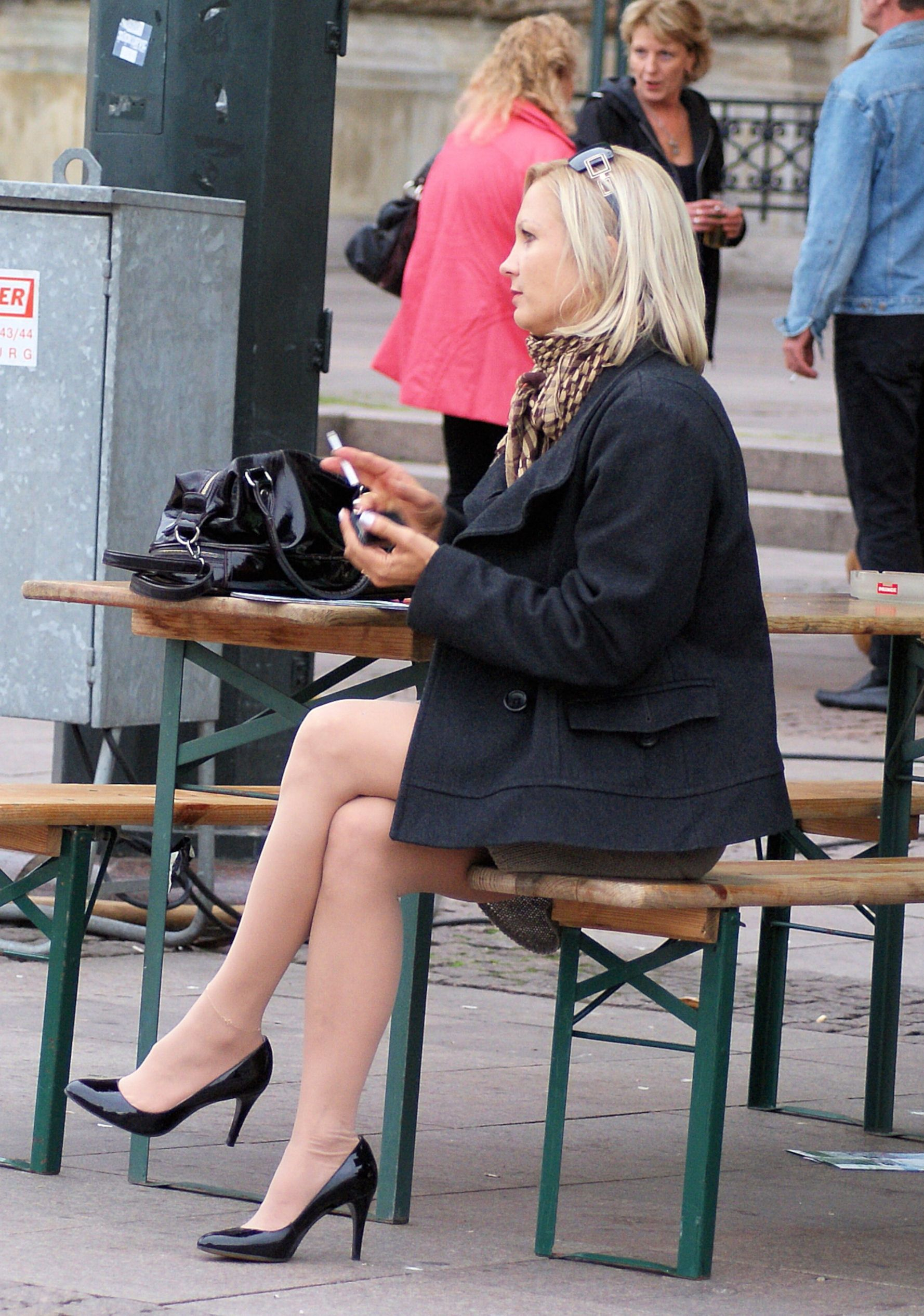 Candid mature crossed white legs