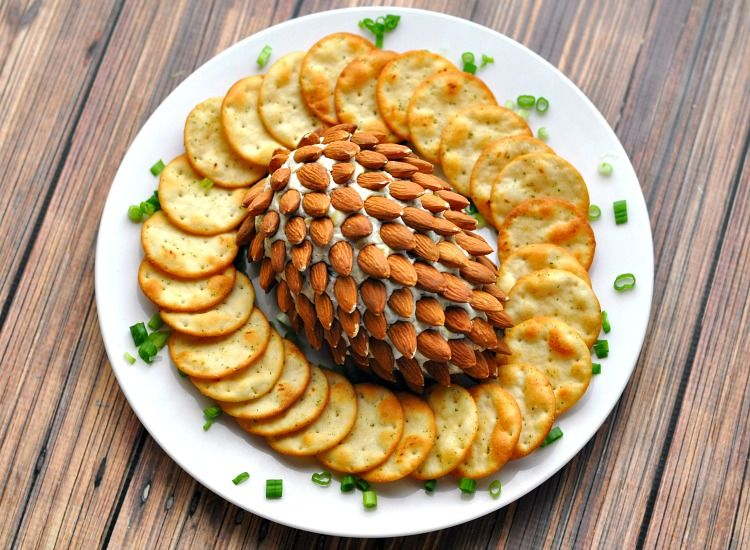 Have you been searching for the best pine cone cheeseball recipe? This Bacon & Herb Pine Cone Cheeseball will have your party guests begging for the recipe!